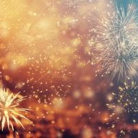 Abstract colorful holiday background of sky with fireworks and stars